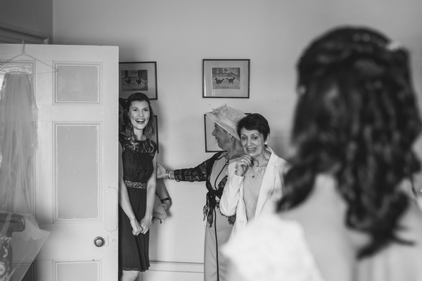 Woman seeing bride in wedding dress for the first time