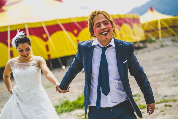 Groom with clown face leading bride by the hand