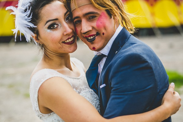 Bride with groom who has clown face