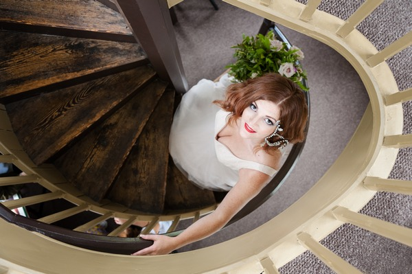 Bride on spiral staircase at The Duke of Cornwall Hotel