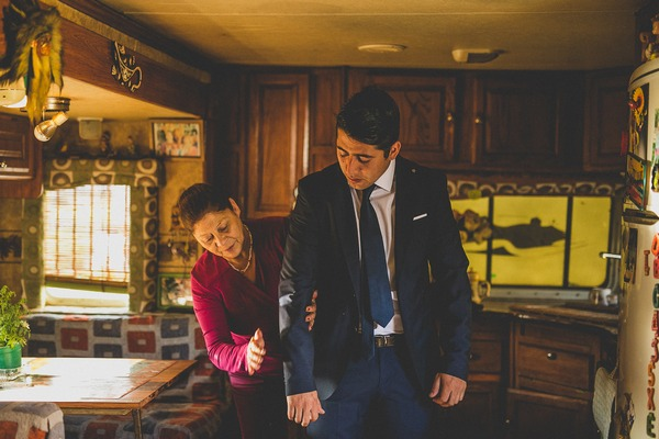 Groom's mother helping with suit