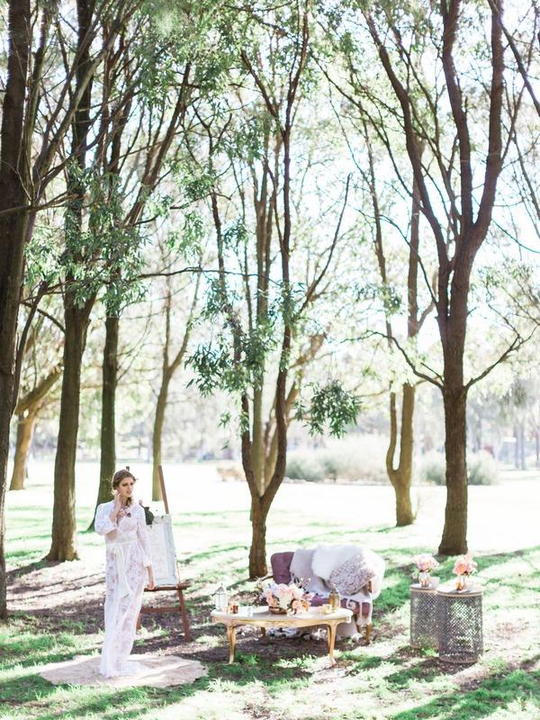 Bohemian bride in woodland wedding setup