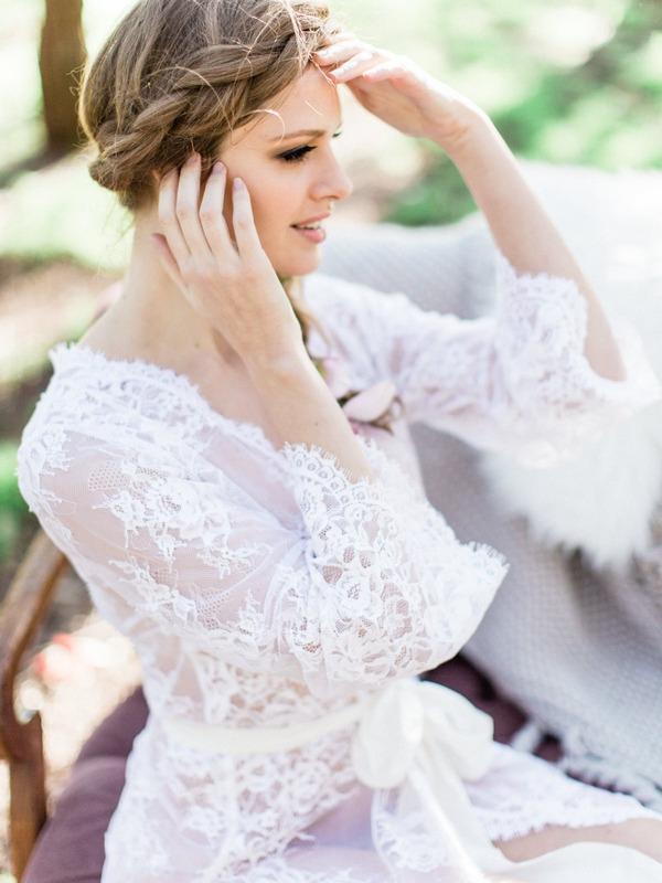 Lace detail on bohemian bride's wedding robe
