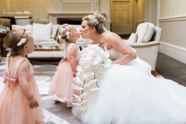 Bride kissing young flower girl - Picture by Gemma Giorgio Photography
