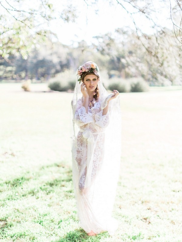 Bohemian bride wearing lace robe and flower crown