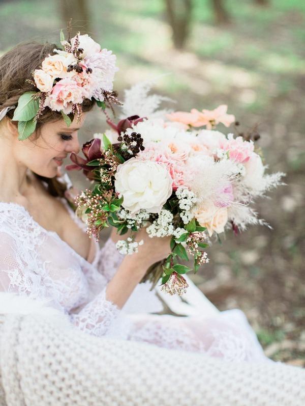 Bohemian bride holding large pastel wedding bouquet
