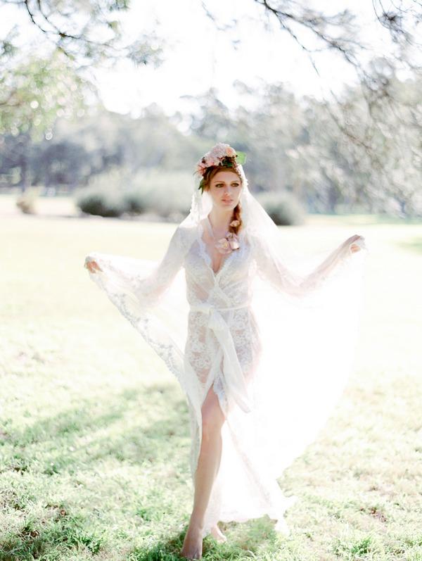 Bohemian bride wearing see through lace wedding robe