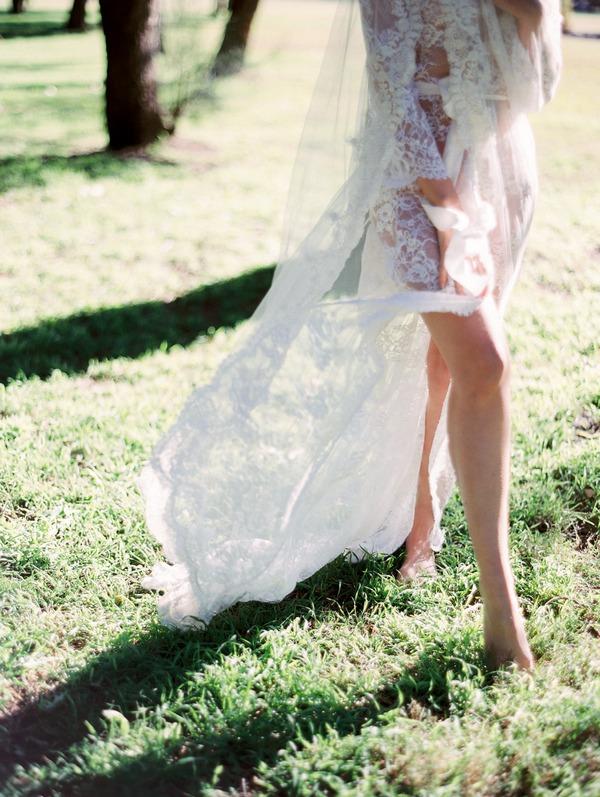Bride's legs as she walks on grass
