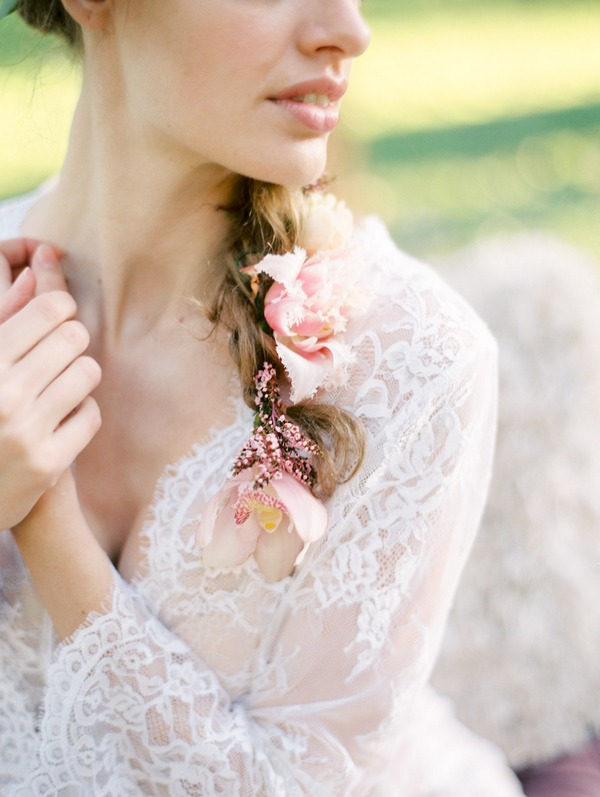 Bohemian bride's ponytail with flowers