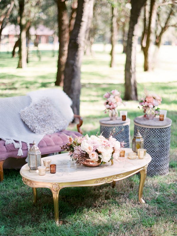 Table with wedding flowers in woodland