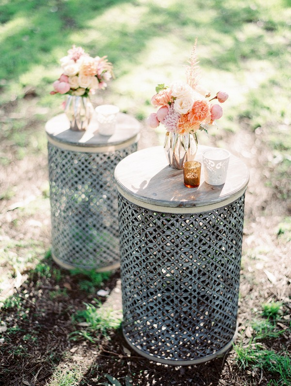 Vases of flowers on rustic tables
