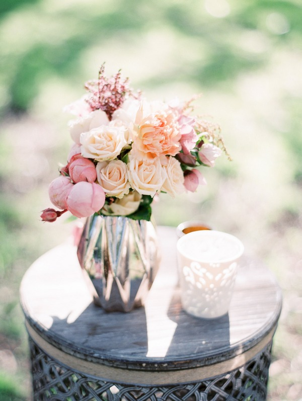Vase of pastel coloured wedding flowers