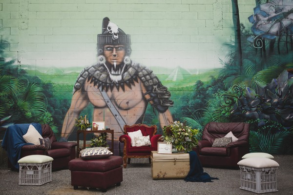Chairs and sofas in urban setting with wall art