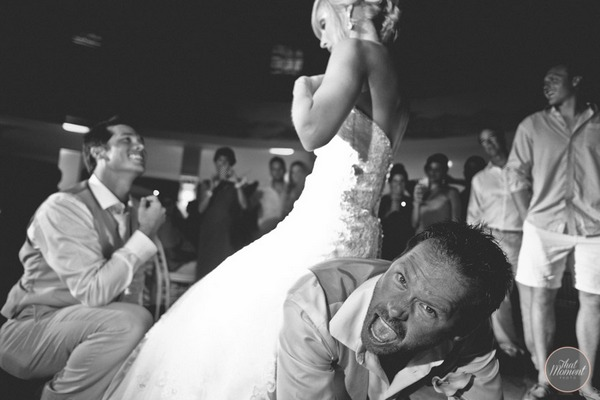 Man shouting with bride sitting on his back - Picture by That Moment Photo