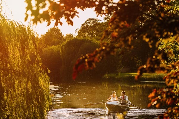 Bride and groom on rowing boat on lake - Picture by Paul Joseph Photography