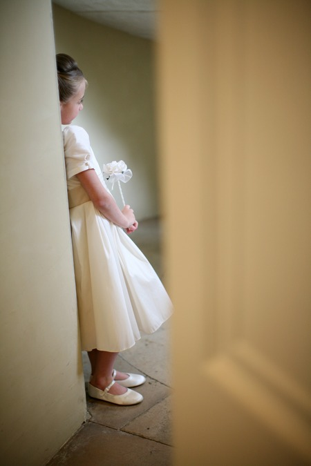 Flower girl leaning against wall - Picture by AVA Images