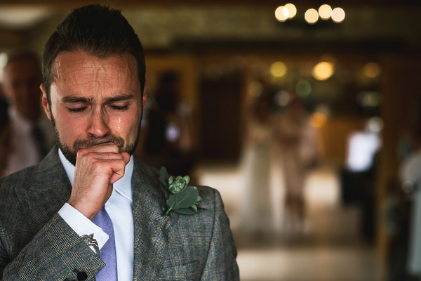 Emotional groom crying as bride walks down the aisle - Picture by Kristian Leven Photography