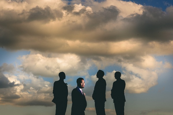 Silhouettes of groomsmen with groom in foreground - Picture by Ash Davenport of Miki Photography