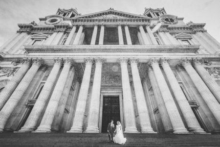 Bride and groom standing on steps of St Paul's Cathedral - Picture by Nick Ray Photography