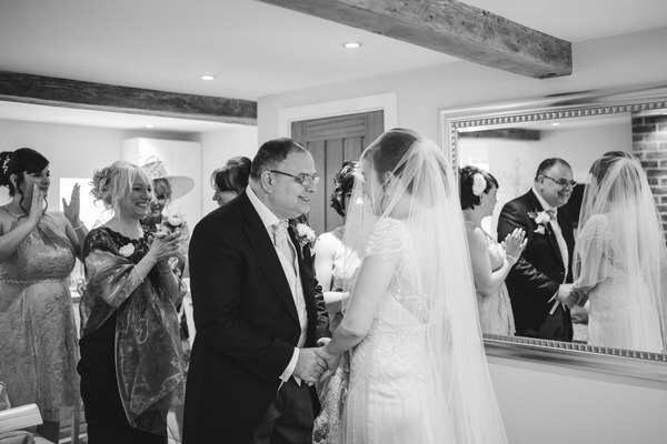 Father seeing bride for first time on wedding day
