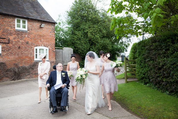 Bride and bridesmaids walking with bride's father to wedding ceremony at Packington Moor