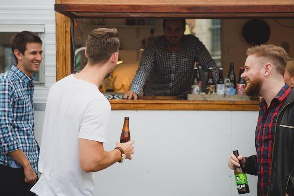 Men at caravan bar