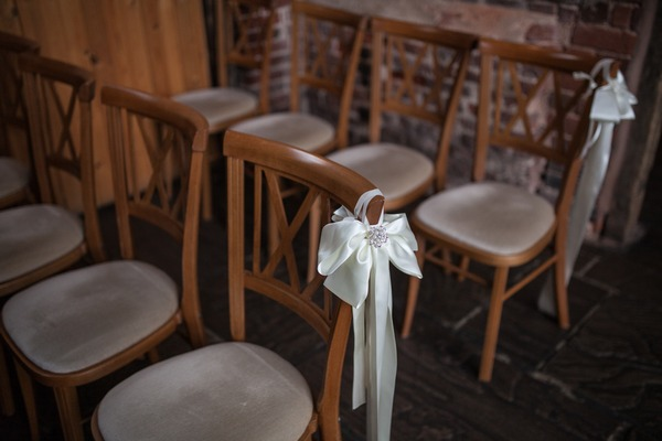 Ribbon bow tied to ceremony chair