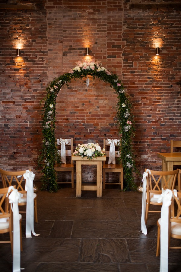Flower arch altar at Packington Moor wedding