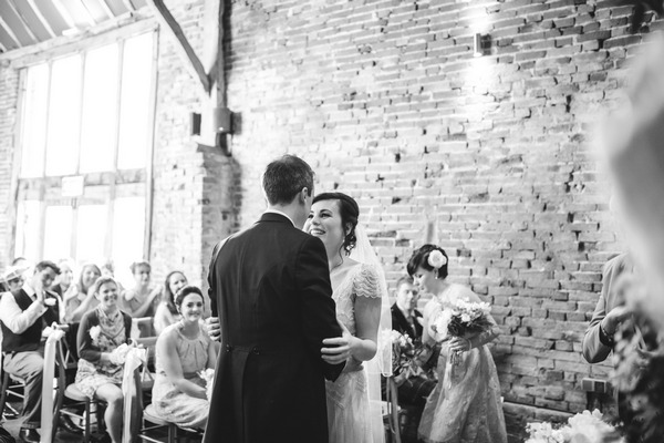 Bride and groom kiss at Packington Moor wedding