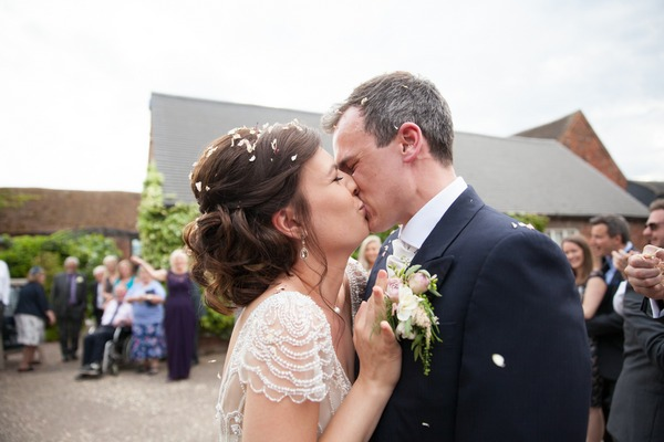 Bride and groom kissing at Packington Moor