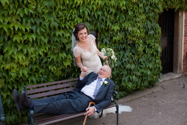 Bride with man laying on bench