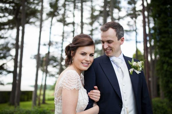 Bride holding onto groom's arm