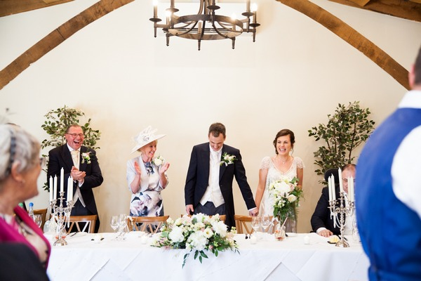Bride and groom take seats at top table