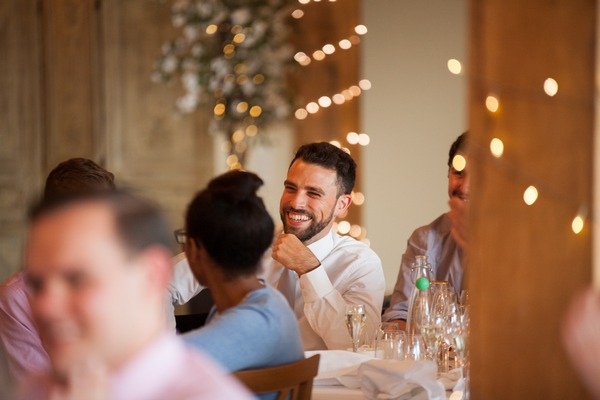 Guest laughing at wedding speech