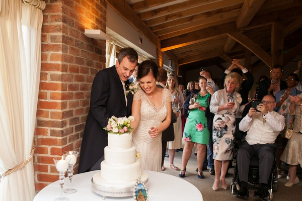 Bride and groom cutting cake at Packington Moor wedding
