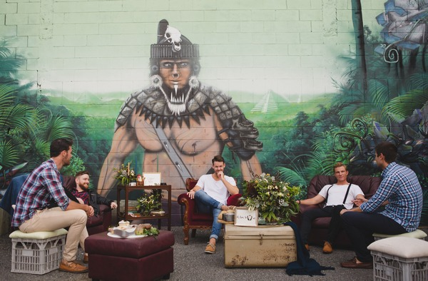 Men sitting in cool, urban setting with wall art
