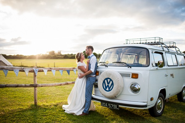 Bride and groom standing next to VW Camper van - Picture by Daniel Photography