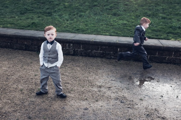 Pageboy standing with hands in pockets as another boy runs past - Picture by Shaun Carr Photography