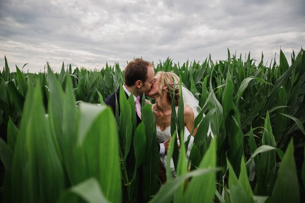Bride and groom kissing in cornfield - Picture by Stephen McGowan Wedding Photography
