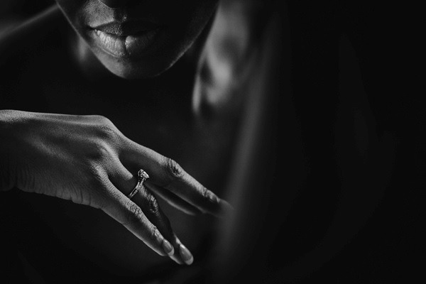 Looking at wedding ring on finger - Picture by Abi Riley Photography