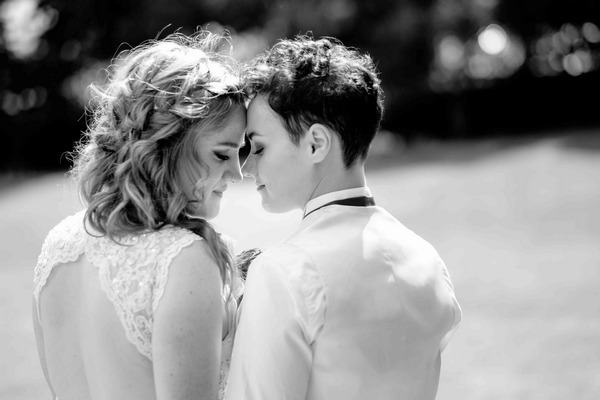 Two brides touching heads - Picture by Chris Loneragan Photography