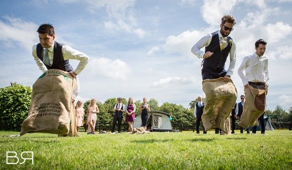 Groomsmen doing sack race at wedding - Picture by Brian Robinson Photography