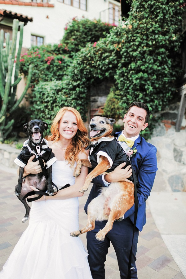 Katie Leclerc and Brian Habecost holding dogs