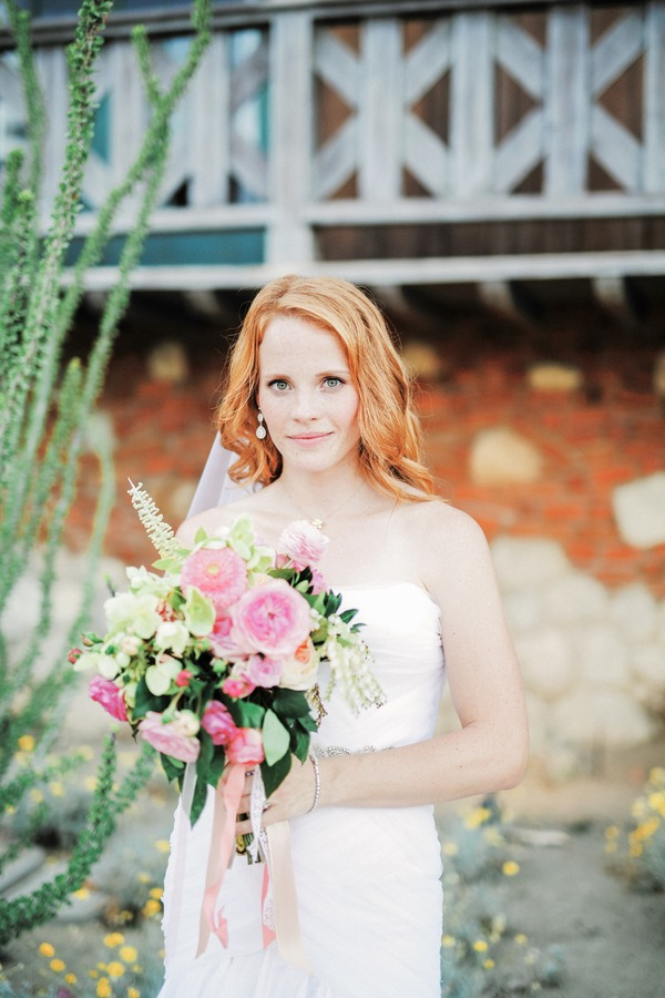 Katie Leclerc holding wedding bouquet