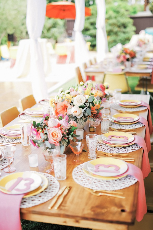 Long wedding table with colourful styling