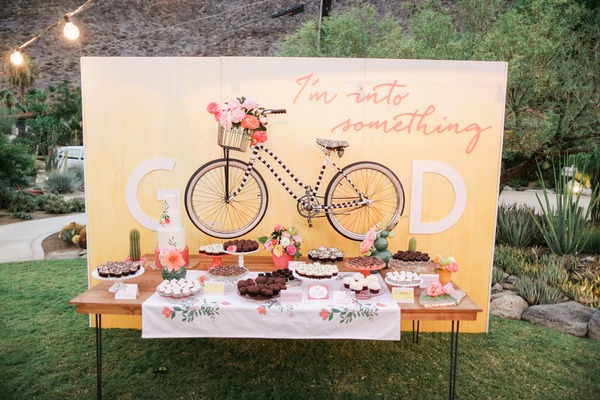 Wedding cake table with bicycle backdrop