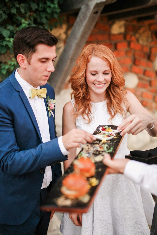 Katie Leclerc and Brian Habecost taking canapés