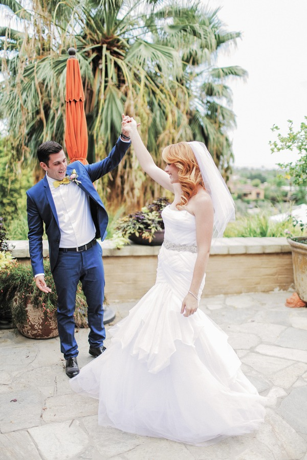 Katie Leclerc and Brian Habecost twirl at wedding