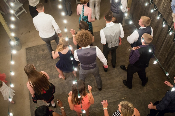 Lines of wedding guests dancing