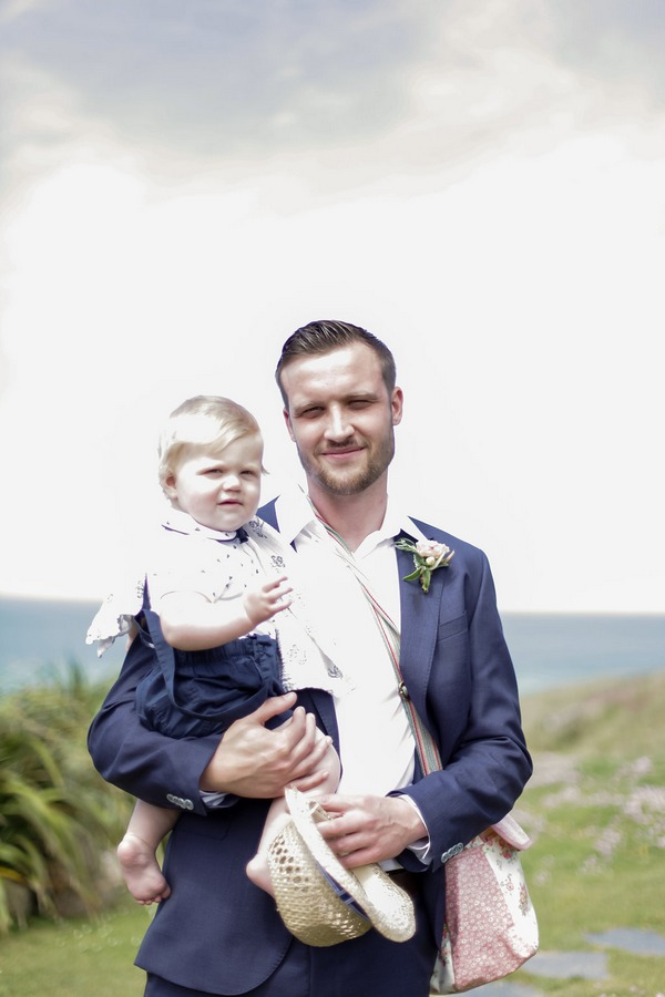 Groom holding pageboy son
